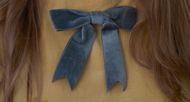 blow tie ribbon mustard coloured silk hair light blue